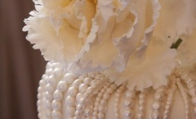 Elegant Wedding Cake - All white, pearls, oversized flowers - total elegance for a black tie affair.